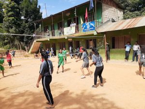 Women playing volleyball in rural village in Nepal